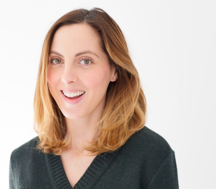 Eva Amurri Martino smiles with her medium length hair styled in a blowout