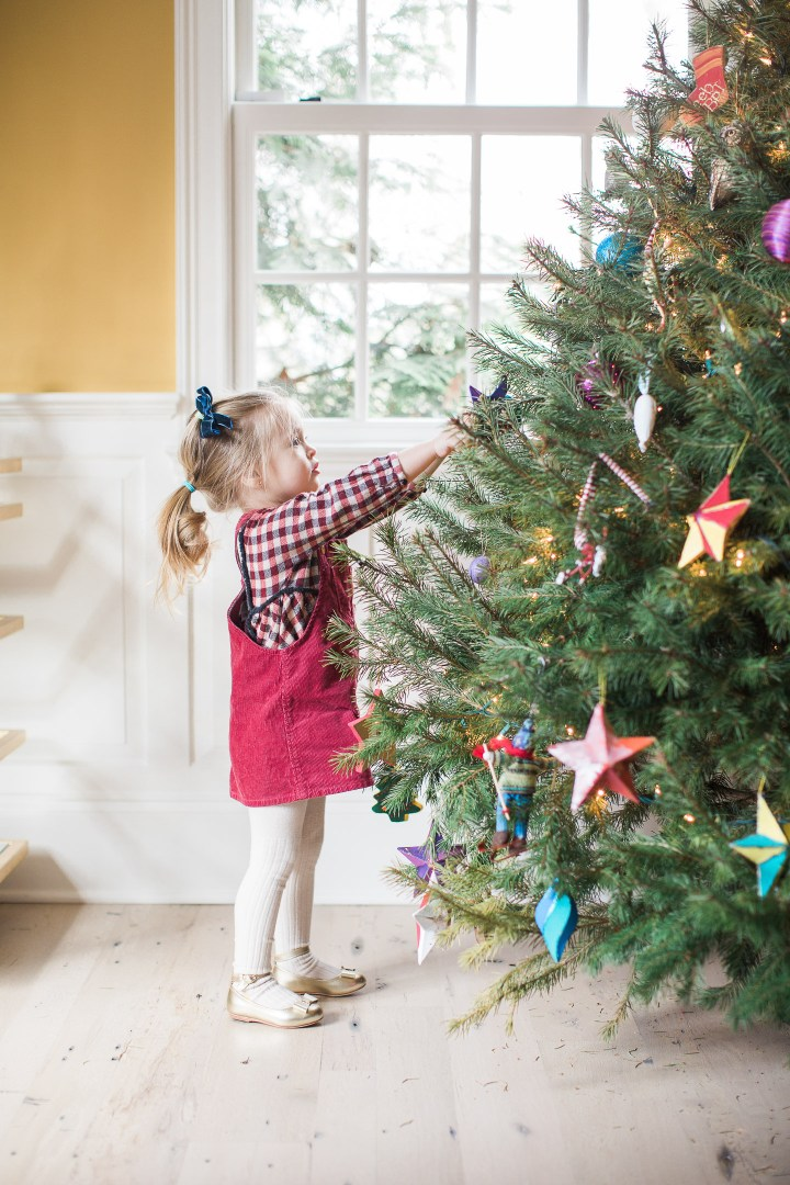 Marlowe Martino decorates the Christmas tree