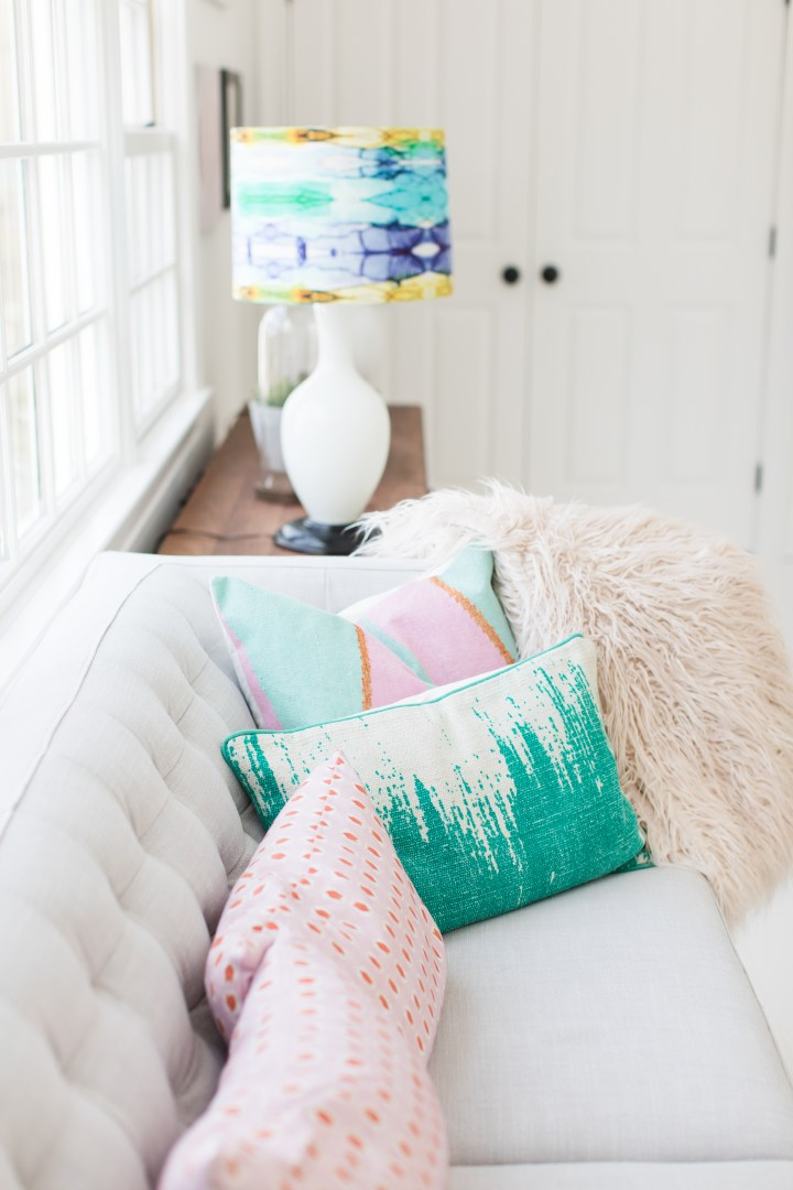 an array of pillows on the couch in the Happily Eva After sitting area