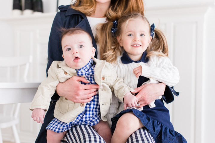 Marlowe Martino and Major Martino sit on their Mom's knee in coordinating navy blue and white secondhand outfits