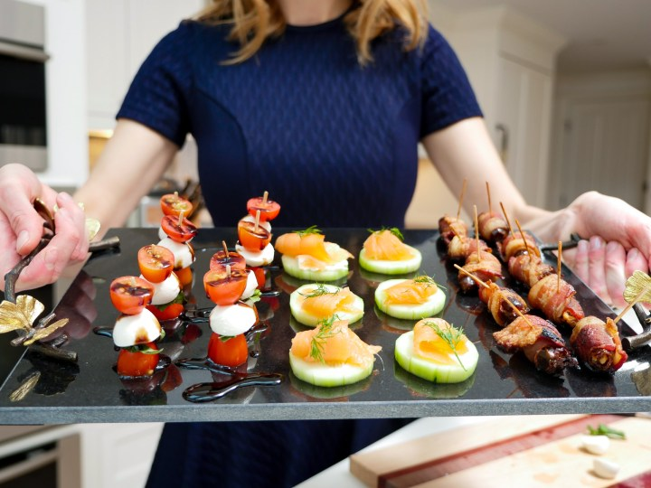 Eva Amurri Martino holds a tray of three easy hors d'oeuvres to serve at your next cocktail party