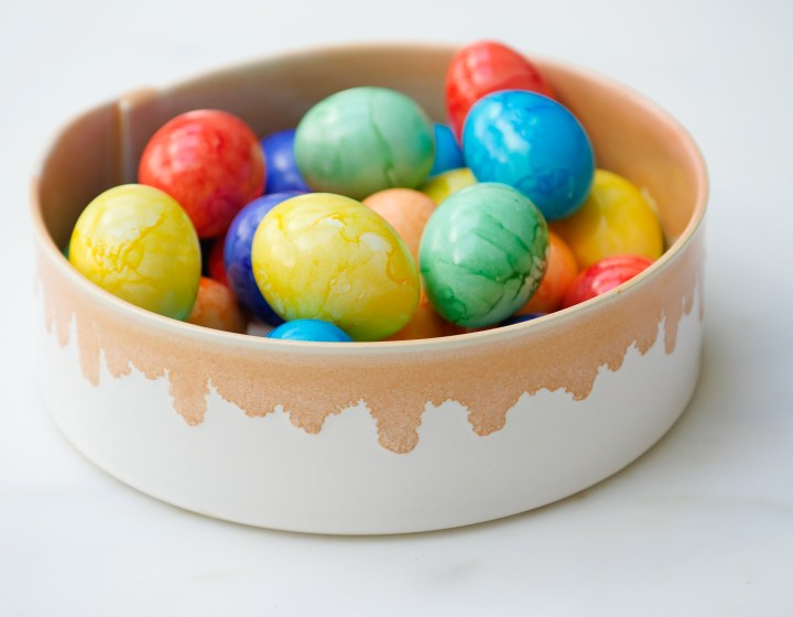 Multicolored marbled Easter Eggs in a dip dyed bowl