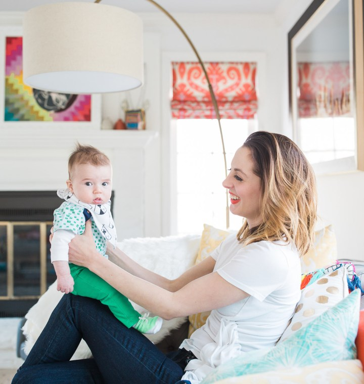 Eva Amurri Martino holds her infant son, Major, on her knee in the colorful family room of her Connecticut home