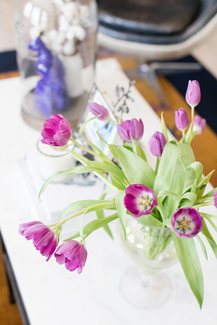 Purple tulips in full bloom on the coffee table of Eva Amurri Martino's Connecticut home
