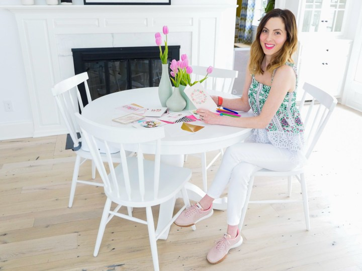 Eva Amurri Martino sits at her kitchen table to fill out a collection of Hallmark Signature Mother's Day cards