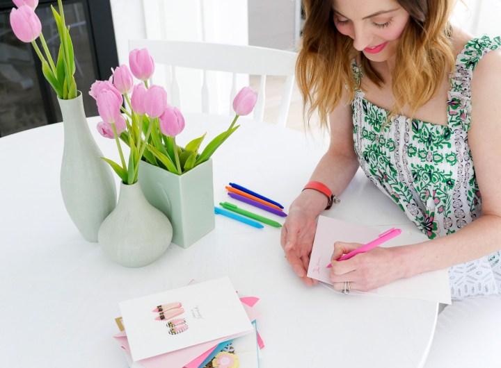 Eva Amurri Martino writes a personal message in the Hallmark Signature card she selected to gift her Mom on Mother's Day