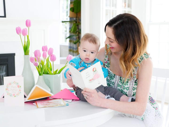 Eva Amurri Martino and her six month old son, Major Martino, look at Hallmark Signature Mother's Day Cards at the kitchen table of their Connecticut home