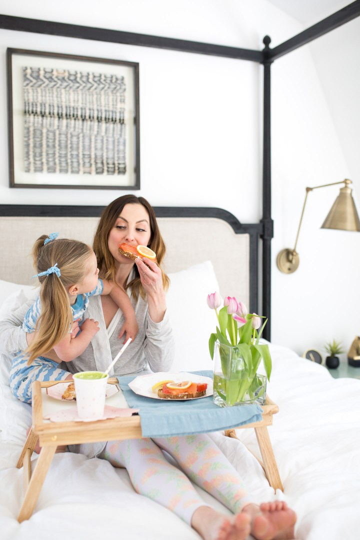 Eva Amurri Martino bites in to Smoked Salmon toast as part of a Mother's Day breakfast in bed