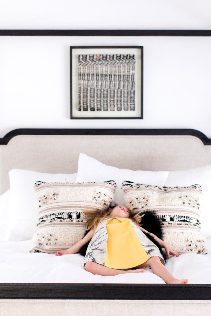 Marlowe Martino lays back on her Mom's black and white patterned bed pillows