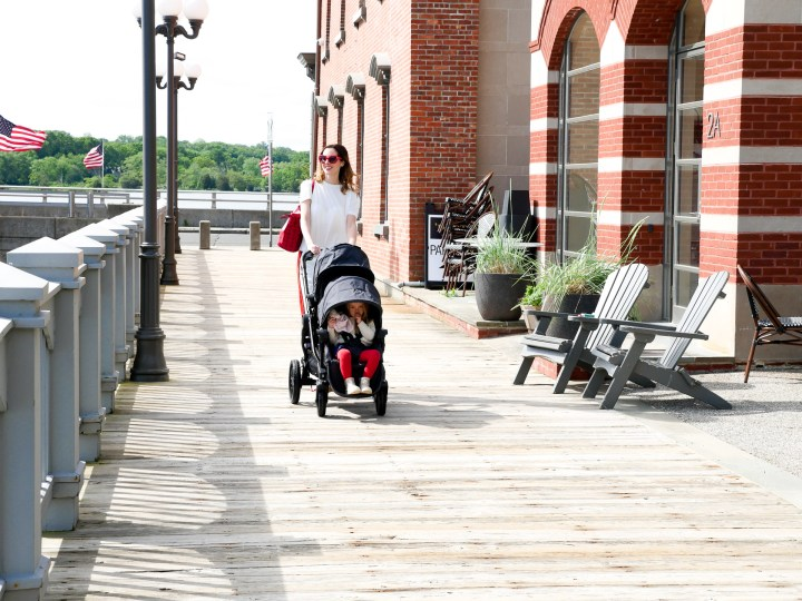 Eva Amurri Martino walks with her two children in a Baby Jogger Stroller down the street in downtown Westport