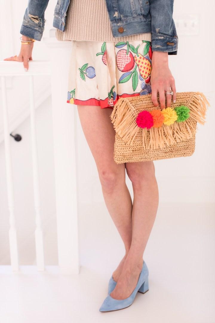 Eva Amurri Martino pairs a DIY Pom Pom Clutch with a colorful summer outfit