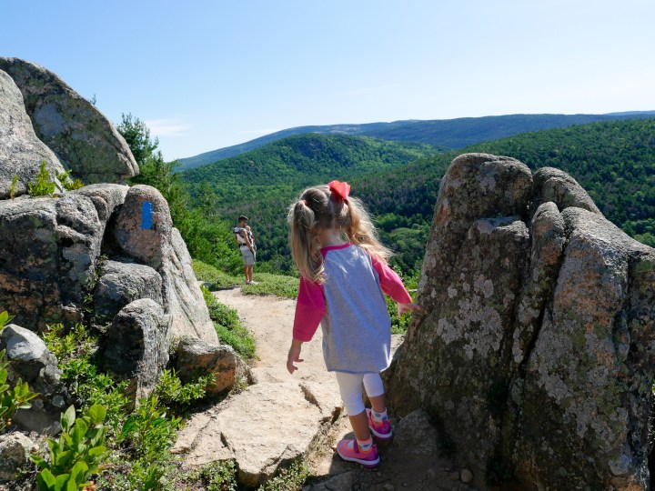 Marlowe Martino hikes along the scenic cliffs in Acadia National park