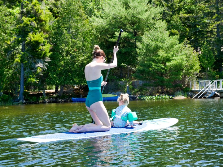 Eva Amurri Martino paddles out on the lake with Marlowe on her paddle board