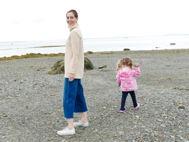 Eva Amurri Martino walks on a pebble beach with daughter Marlowe in the Bar Harbor Area of Maine