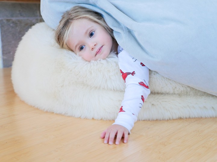 Marlowe Martino lays on a bean bag wearing Lobster pajamas