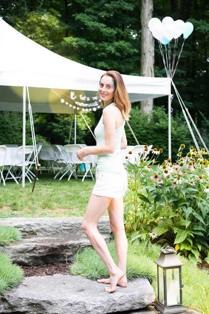 Eva Amurri Martino wears a Mermaid Sercurity tank designed using the Happily App and greets guests at her daughter's third birthday party