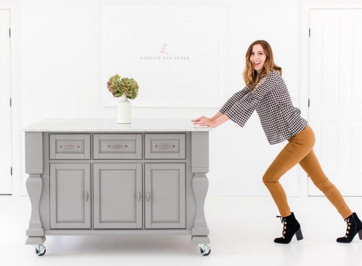 Eva Amurri Martino pushes her grey crafting island across the floor of the Happily Eva After studio