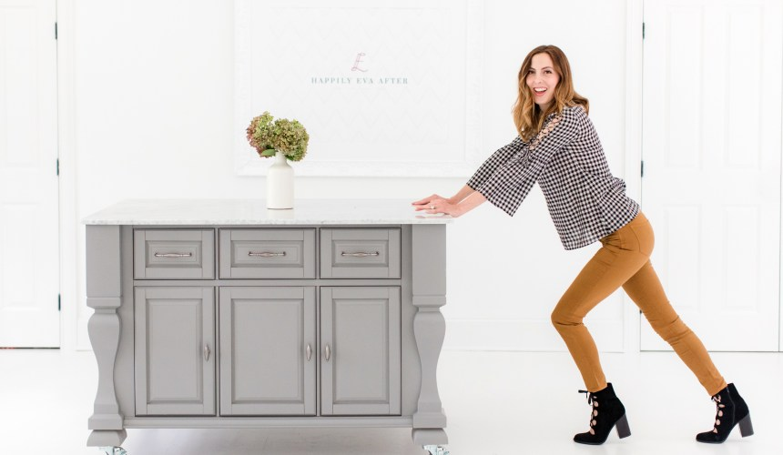 Eva Amurri Martino pushes her grey crafting island across the floor of the Happily Eva After studio