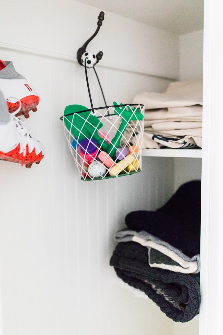 stacks of stroller blankets and canvas bags fill the cubbies next to buckets of kids' activities and Kyle Martino's soccer cleats in Eva Amurri Martino's Connecticut mud room