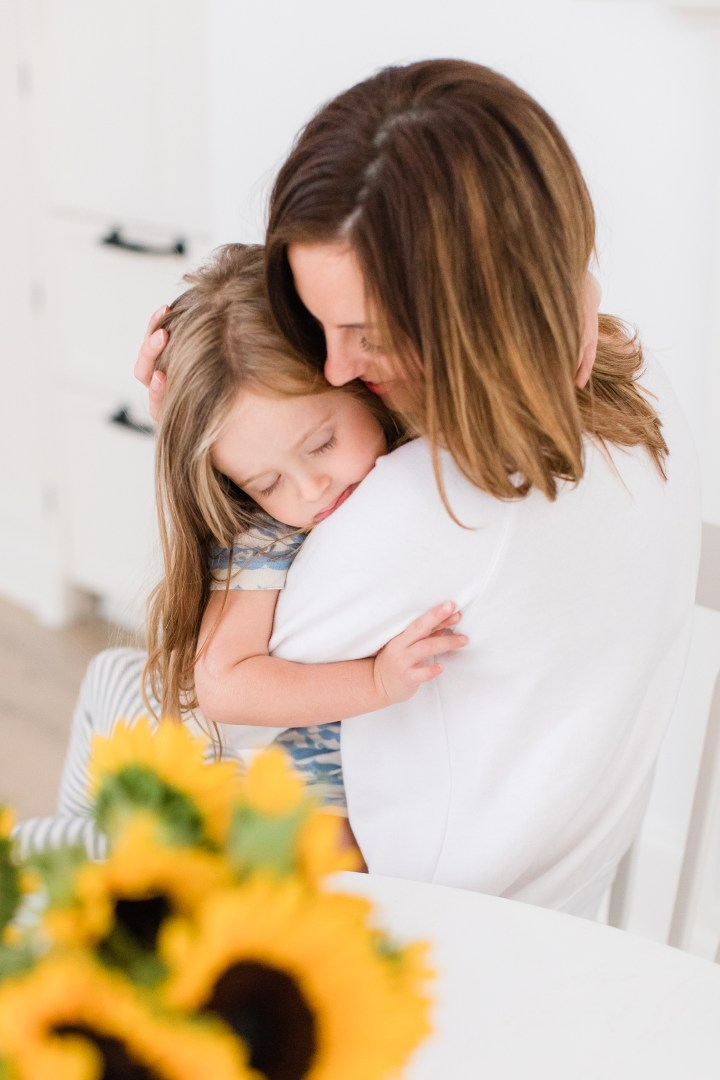 Eva Amurri Martino snuggles with daughter Marlowe at the kitchen table of her Connecticut home