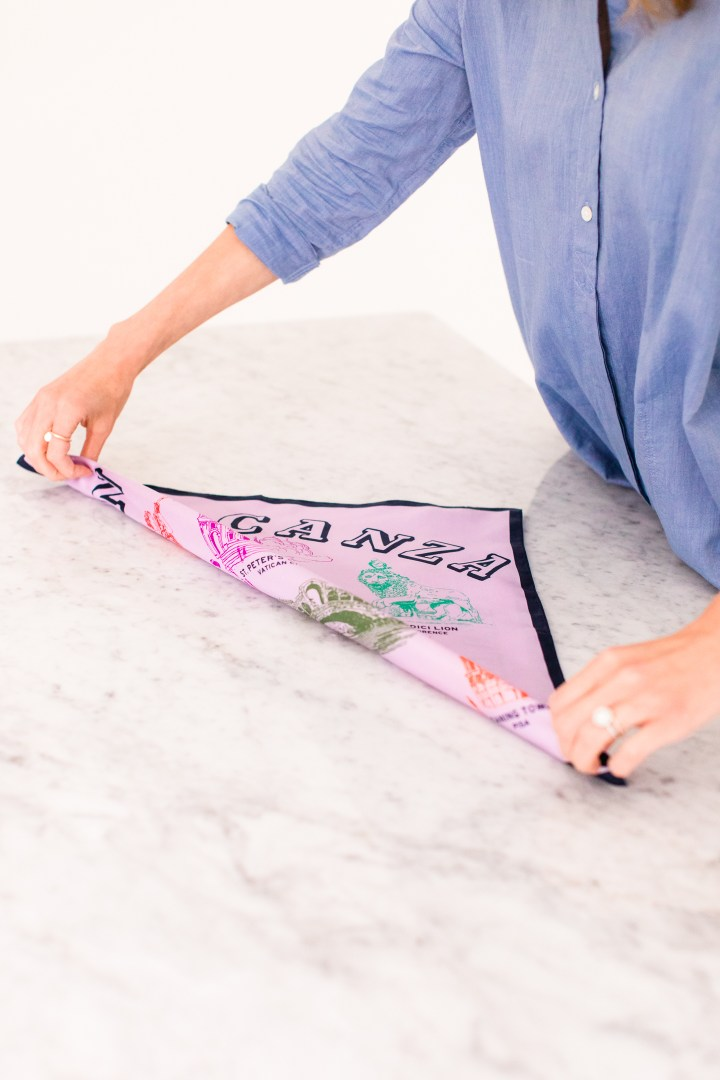 Eva Amurri Martino folds a square silk scarf to tie in to a kerchief choker