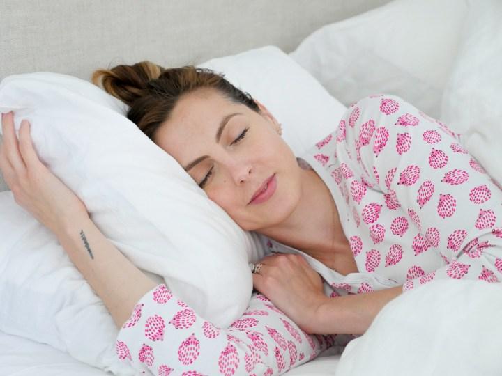 Eva Amurri Martino wears pink printed pajamas and prepares to fall asleep