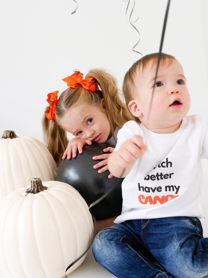 Marlowe and Major Martino wear custom halloween themed tee shirts designed using The Happily App