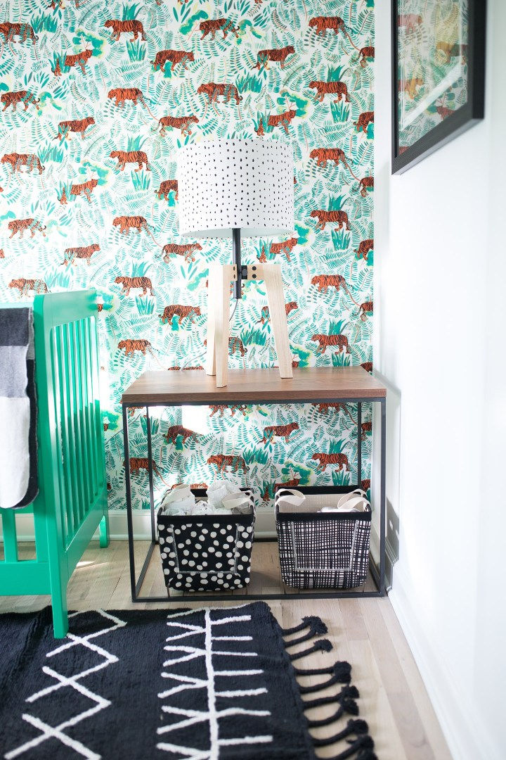 Major Martino's nursery features black and white tribal patterns with kelly green accents and a vibrant tiger wallpaper