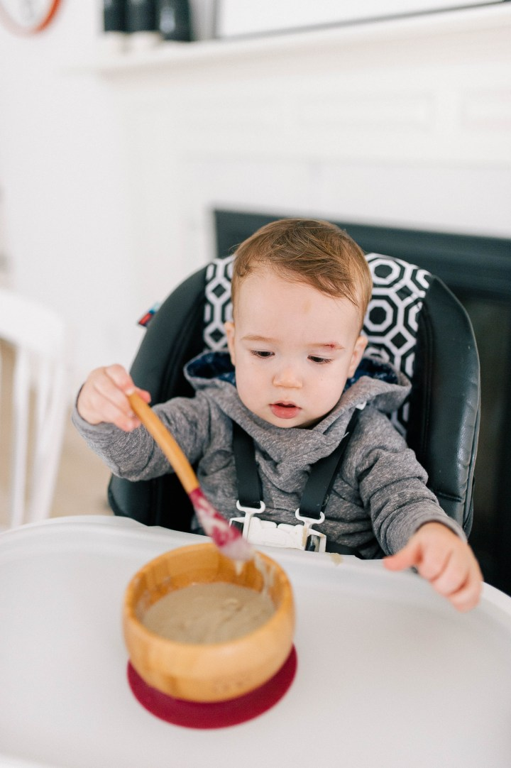 Major Martino eats porridge in his high chair that has SpoonfulOne mixed in to it