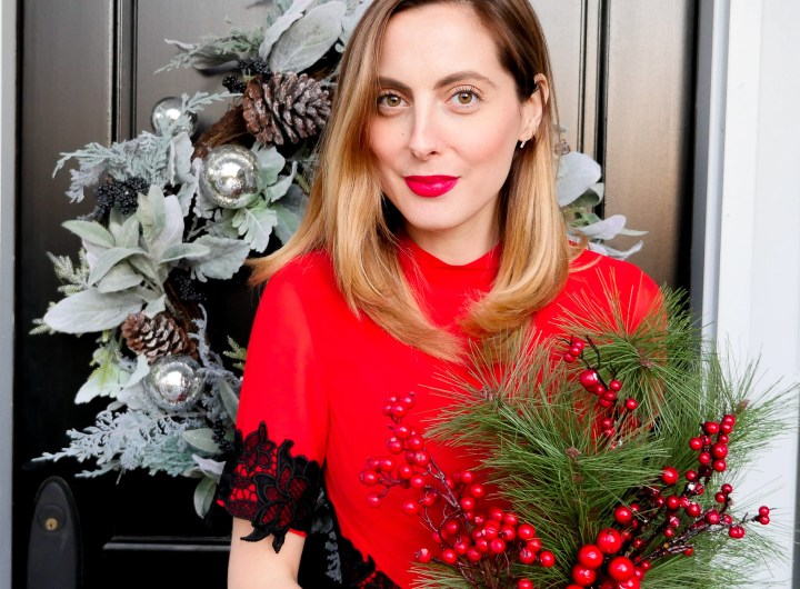 Eva Amurri Martino wears a festive red dress with black lace detailing for a holiday party