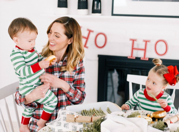 Eva Amurri Martino sits with children marlowe and major around the kitchen table decorated for Christmas brunch