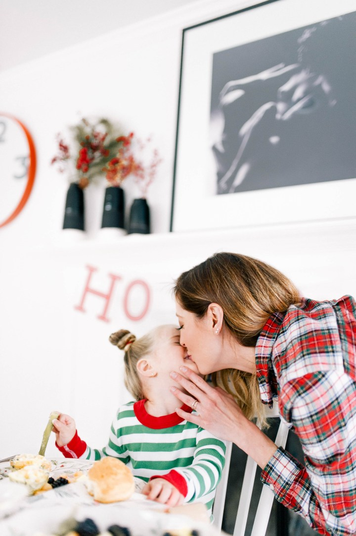 Eva Amurri Martino kisses three year old daughter Marlowe during their festive Christmas brunch at home in Connecticut