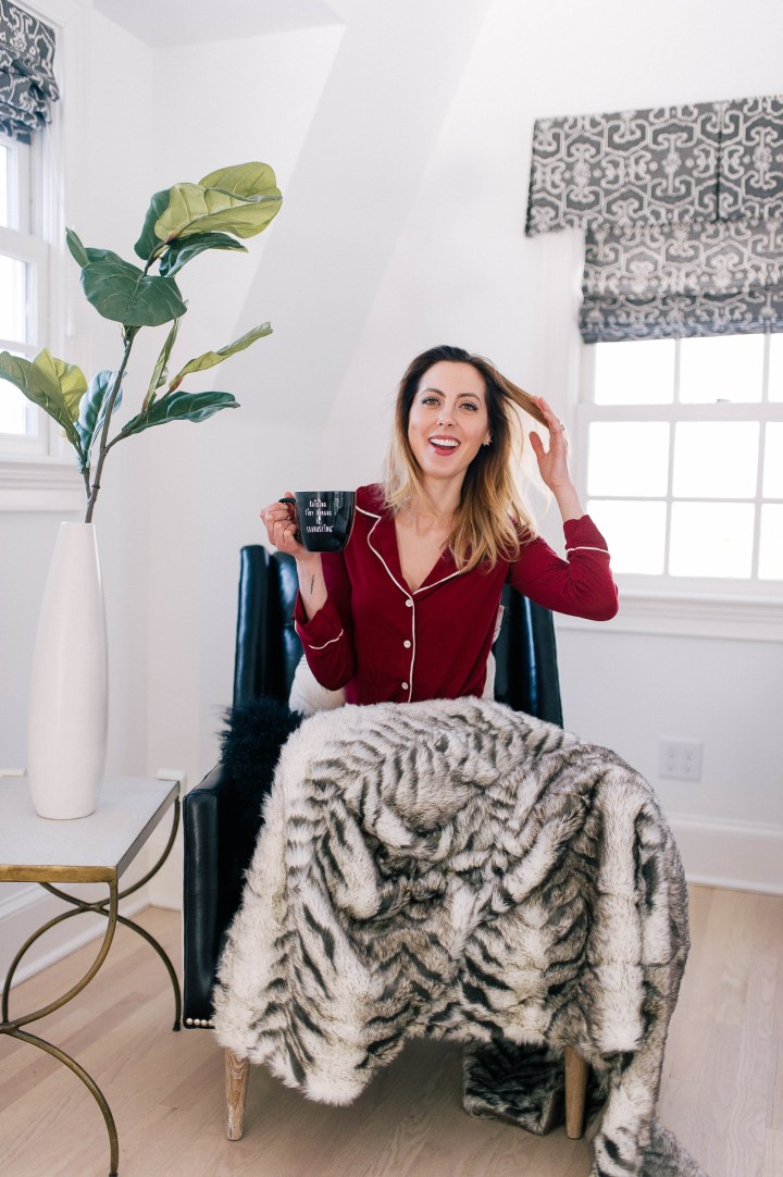 Eva Amurri Martino cozies up in her leather armchair with a fur blanket and a pair of cozy pajamas, holding a cup of tea