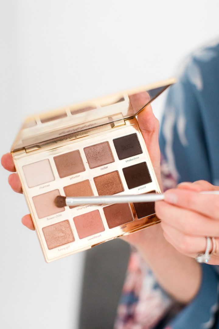 Eva Amurri Martino applies eye shadow as part of her photoshoot makeup tutorial
