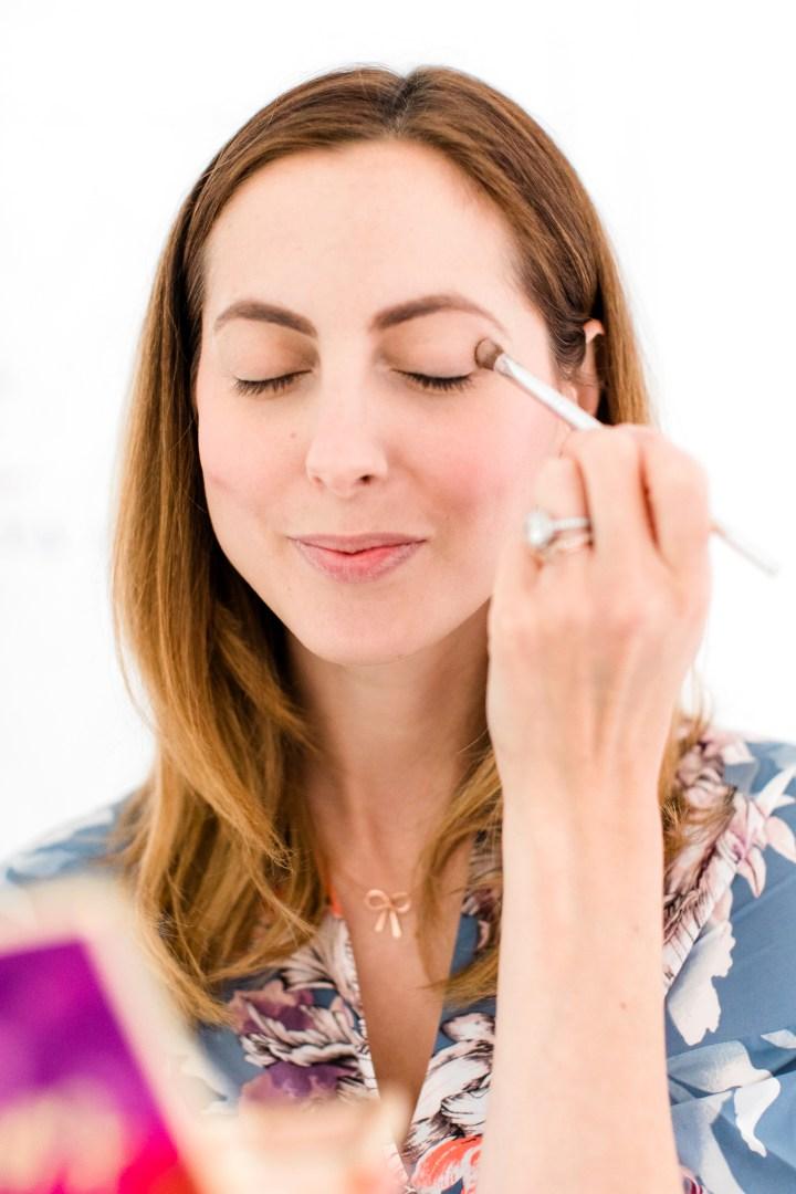 Eva Amurri Martino applies eyeshadow to her lids for a makeup tutorial
