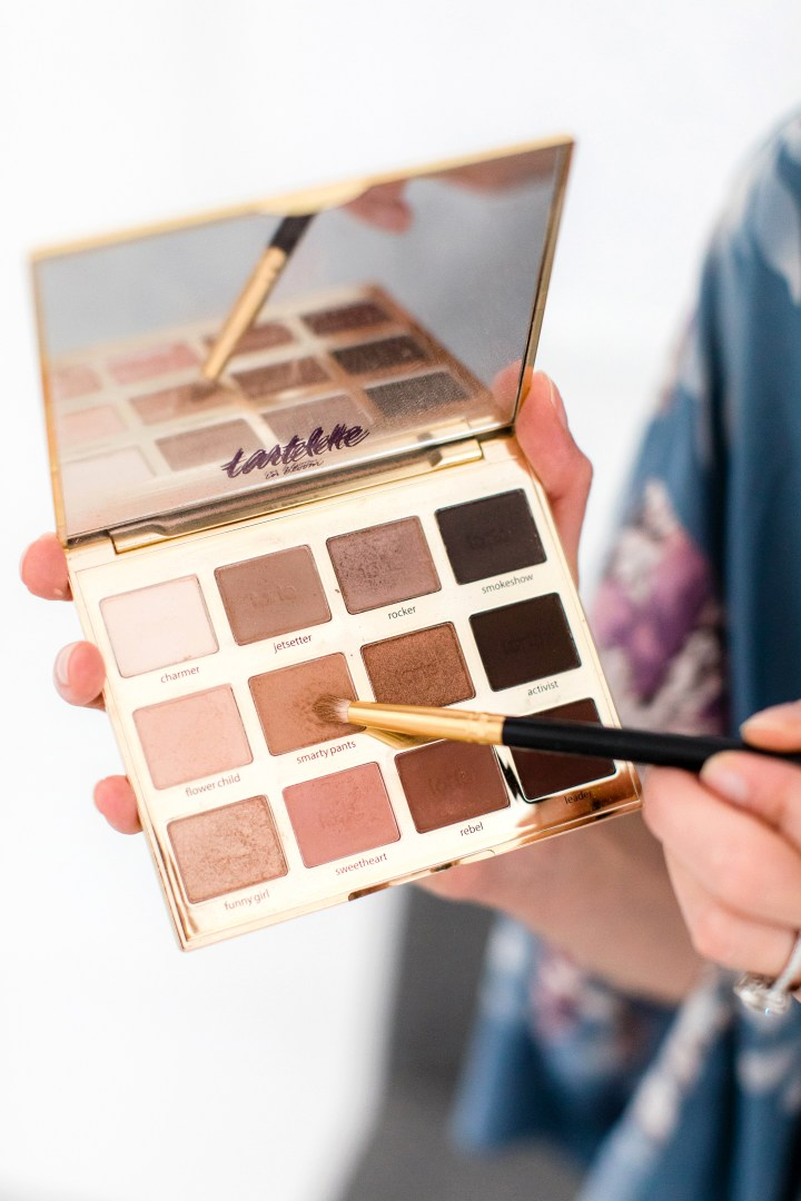 Eva Amurri Martino selects a taupe shadow to apply to her eyelid crease as part of her photo shoot makeup tutorial