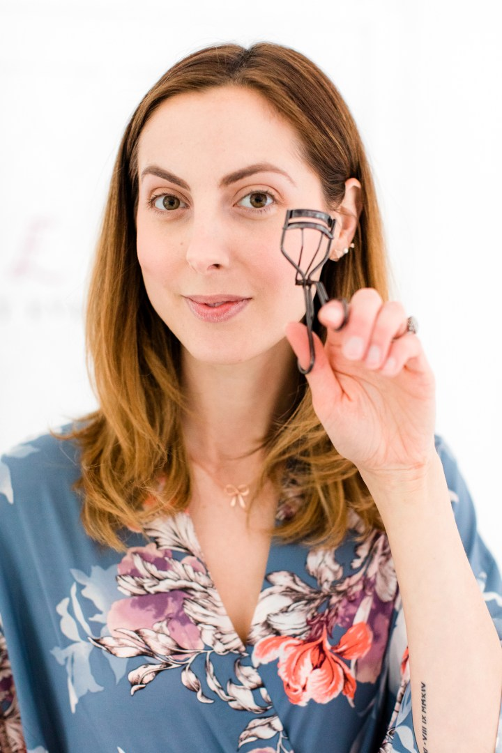 Eva Amurri Martino curls her eyelashes as part of her makeup tutorial