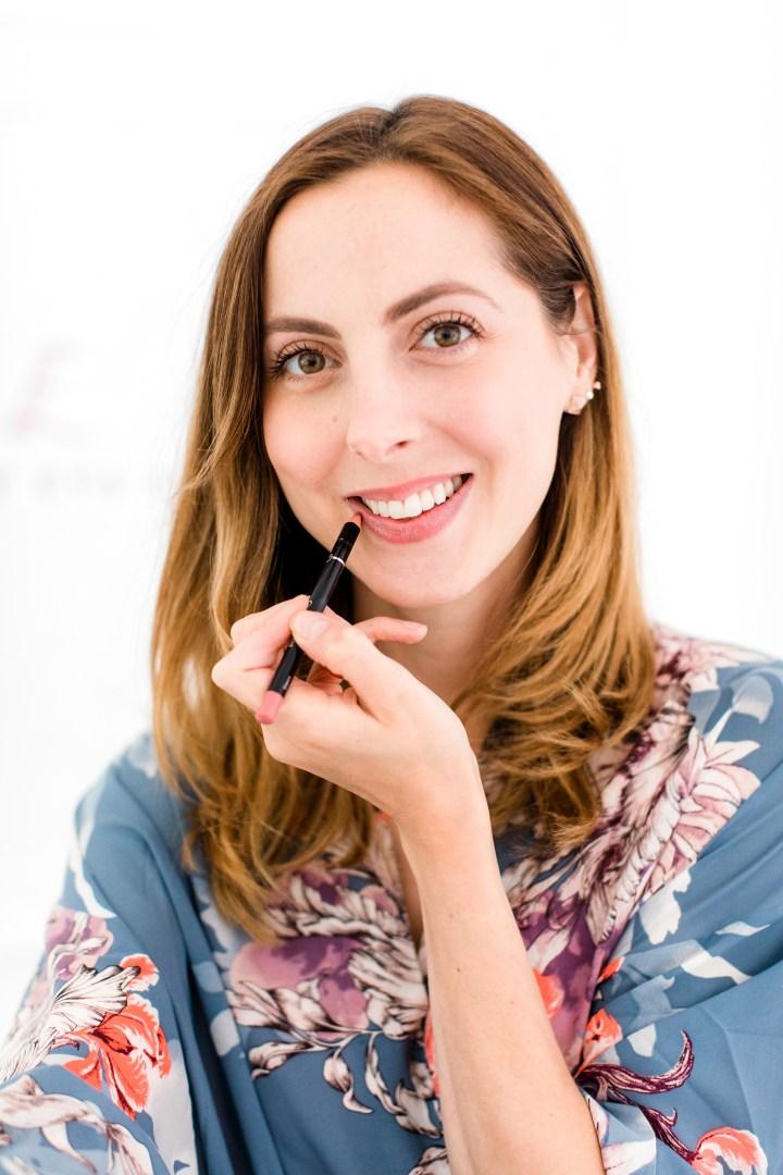 Eva Amurri Martino applies lip pencil to her lips