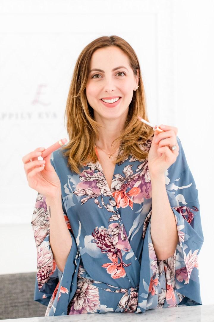 Eva Amurri Martino applies a light sweep of Beauty Counter lipgloss to add shine to her lips