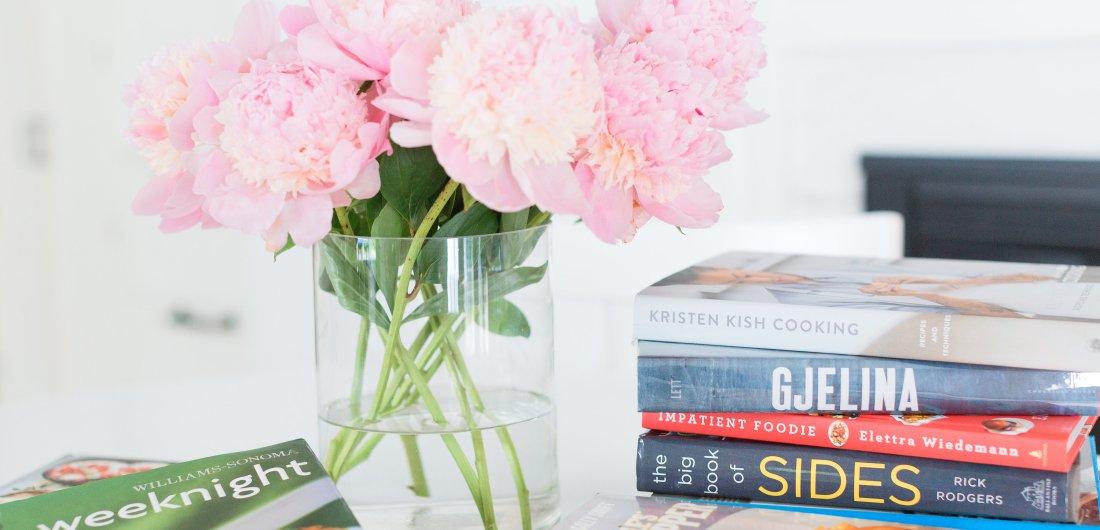 Eva Amurri Martino shares her favorite cookbooks next to a beautiful vase of peonies