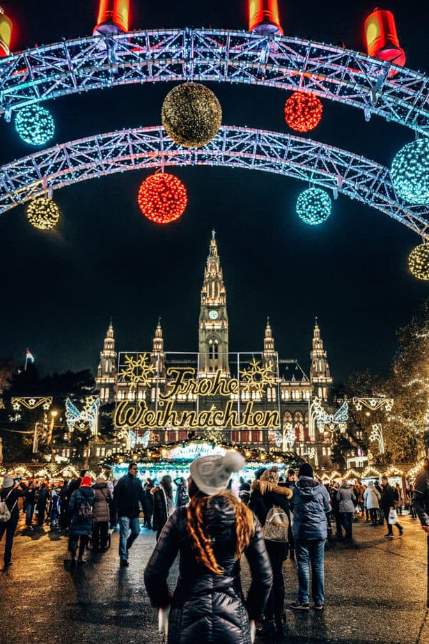 girl standing in front of christmas market in Vienna