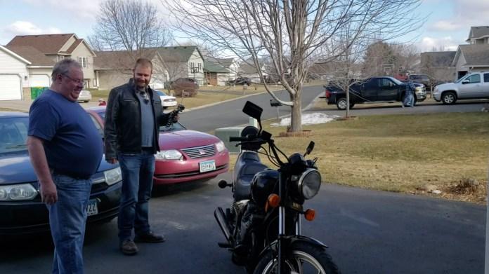The moment Jim Tarpey Snr sees his restored Yamaha Maxim