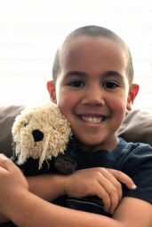 Jacob Cauich with his toy otter