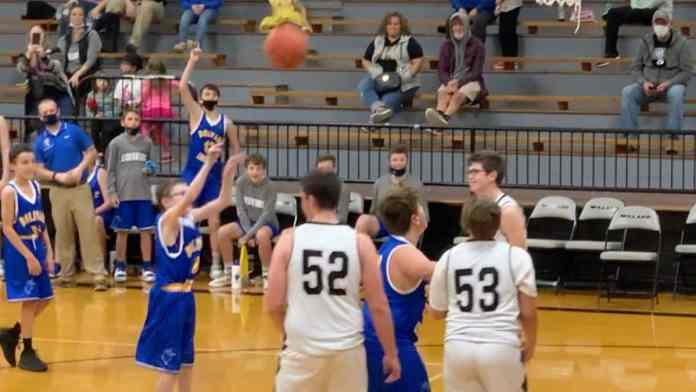 Landon scores during a basketball game