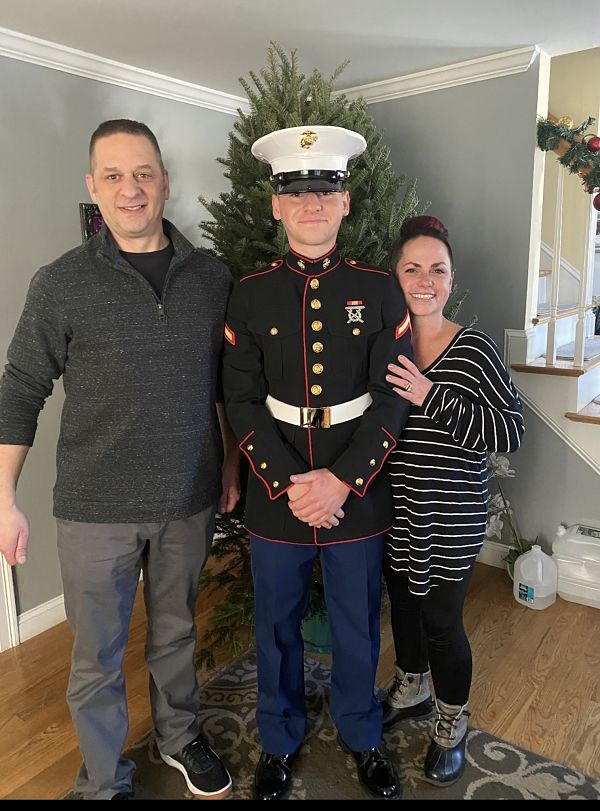 Marine with his mother and father at home