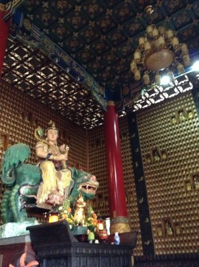 Buddha riding a dragon.