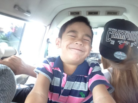 On our way to Pampanga and my cousin goofing around.