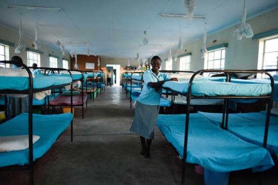 Esther Nyakong, 17 years old sudanese refugee, in the dormitory at Morneau Shepell Secondary School for girls in Kakuma Refugee Camp, Kenya.