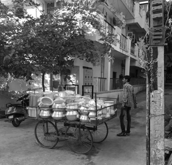 An old picture of the utensil vendor who frequents the area