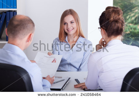 stock-photo-young-girl-gives-her-cv-to-employers-241058464